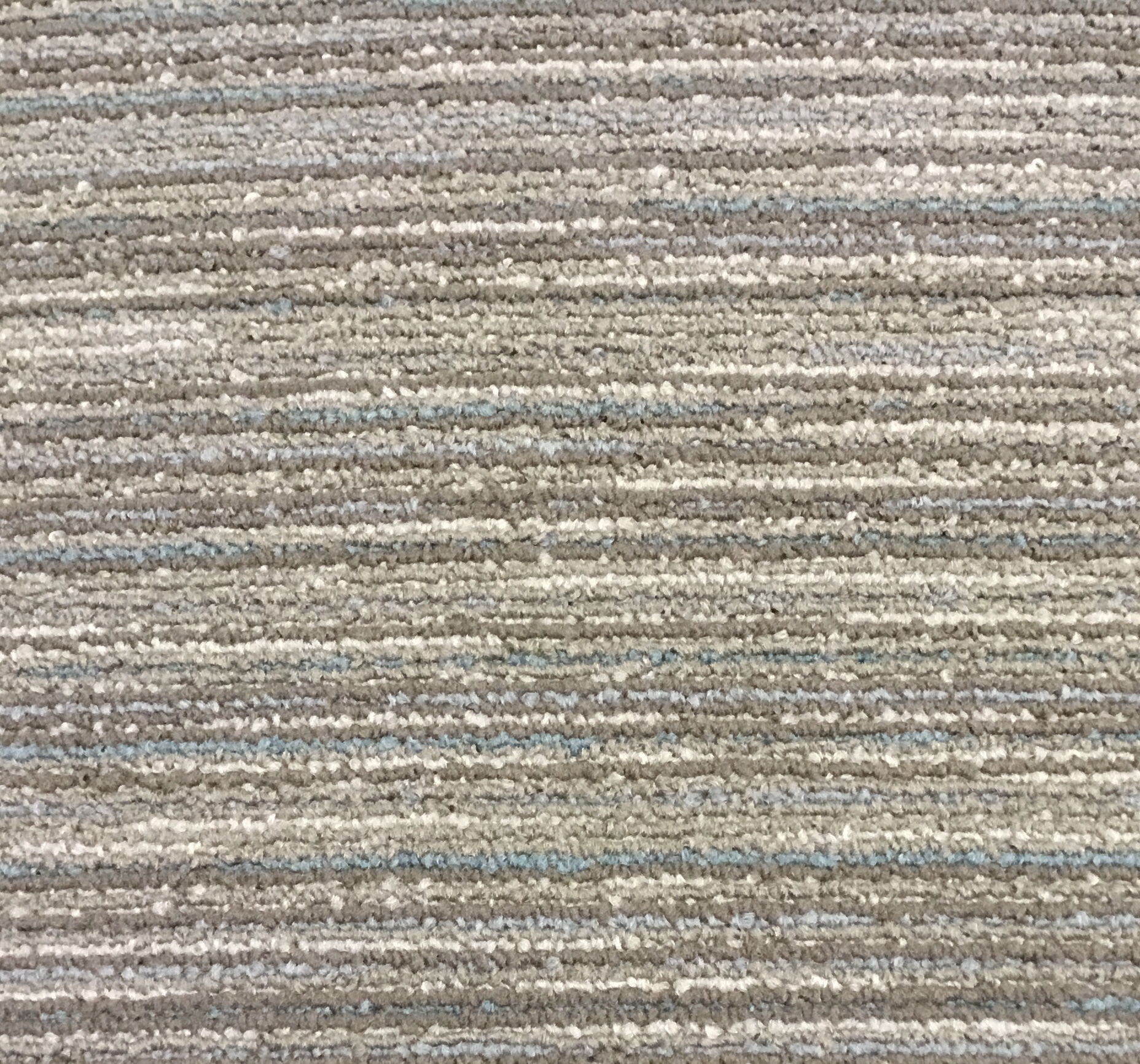 Looking for Interface carpet tiles? Infuse in the color Brown/Blue is an excellent choice. View this and other carpet tiles in our webshop.